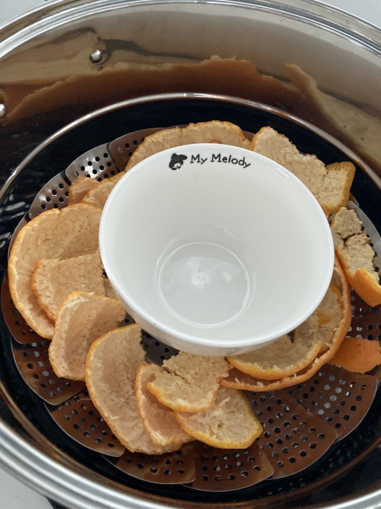 鍋と柑橘の写真